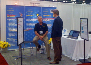 Mike Coffee explains the benefits of Smart ATA to a potential customer.